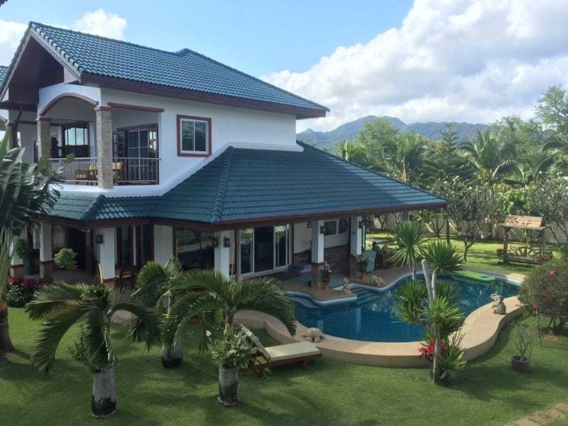 Luxury pool mansion for sale in Thailand palm trees
