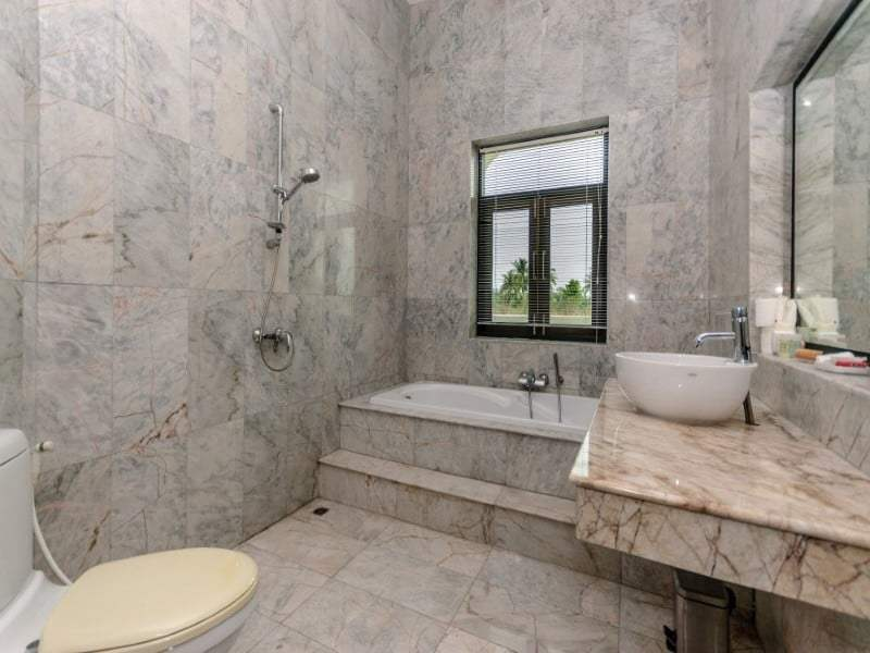 Home for sale next to Black Mountain Golf marble bathroom