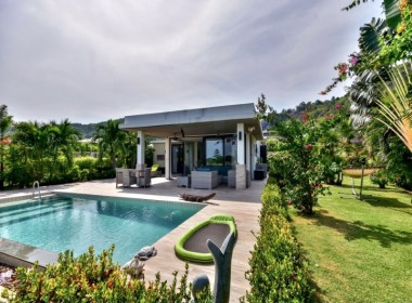 Swimming pool home with sea view for sale side view