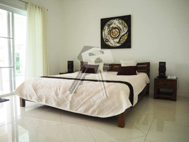Huge Orchid Palm Homes villa for sale master bedroom
